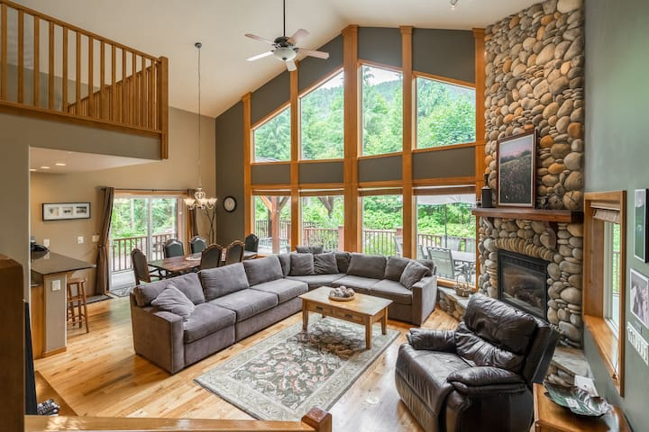 Spacious yet cozy living room with a River Rock gas fireplace.