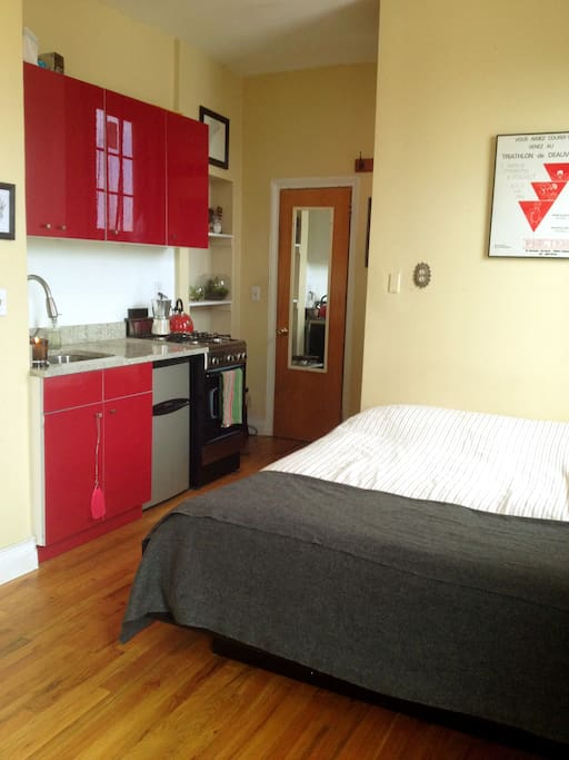 Bed and kitchenette.