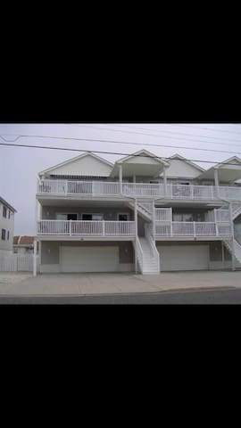 Welcoming Condo with Beautiful Views a Block from the Beach