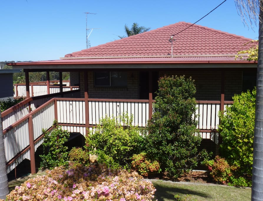 Street-view of home, with wrap-around verandahs on two sides
