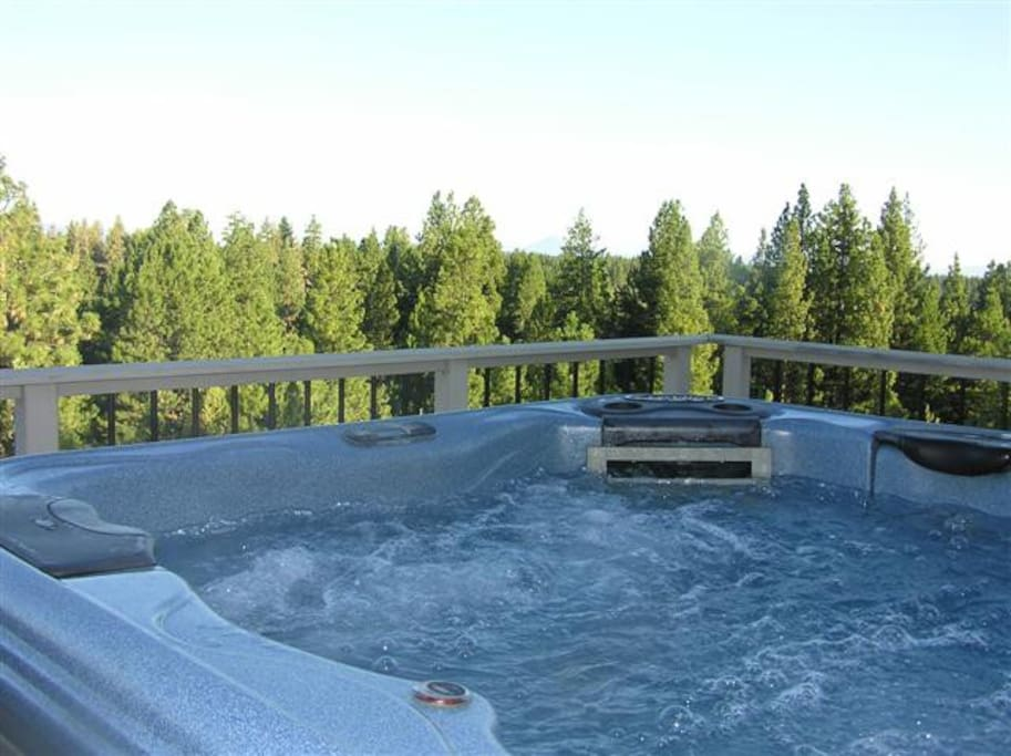 Year round hot tub with mountain views