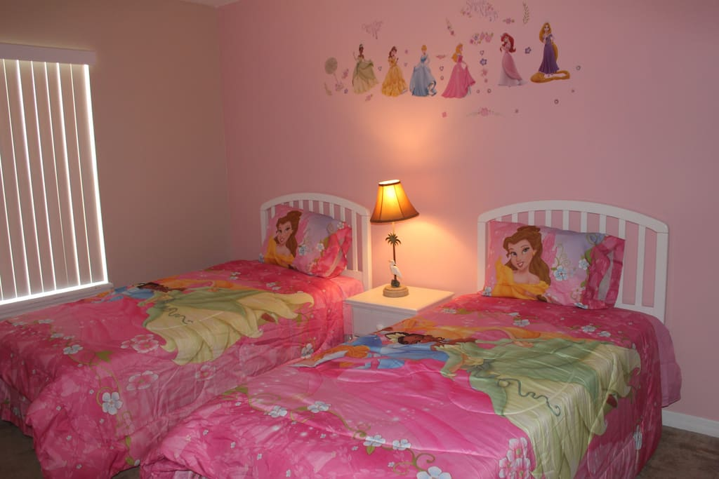 Upstair girls' rooms with two twin beds