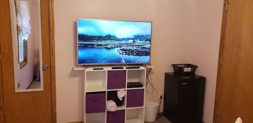 "50 "" smart tv. With cube for storage with a mini fridge in your room with full length mirror.  And fold down desk."
