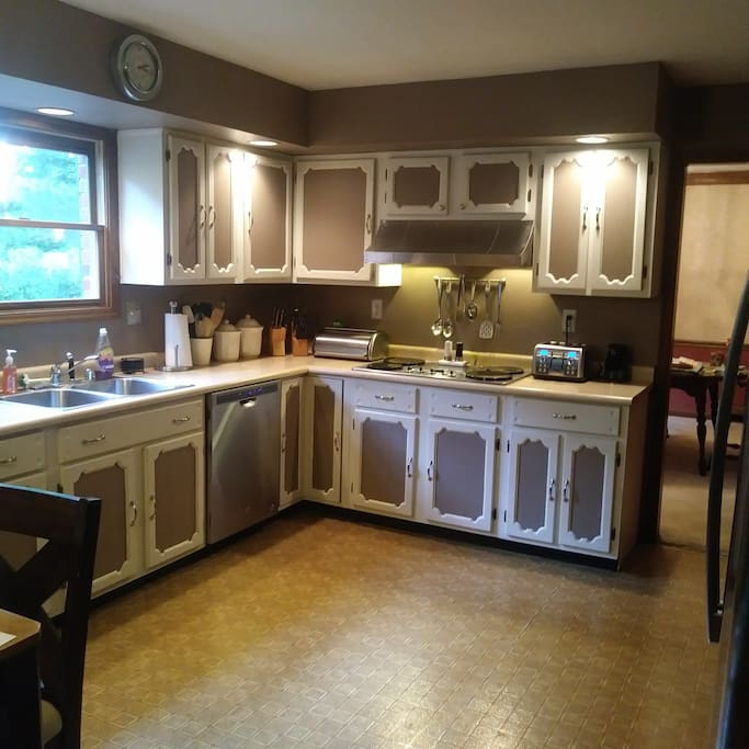 Spacious and fully-stocked kitchen for all of your cooking and dining needs!