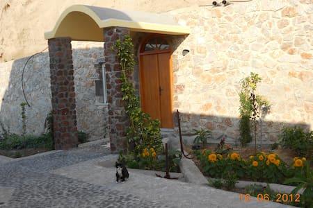 Cave House in Karterados Beach - House