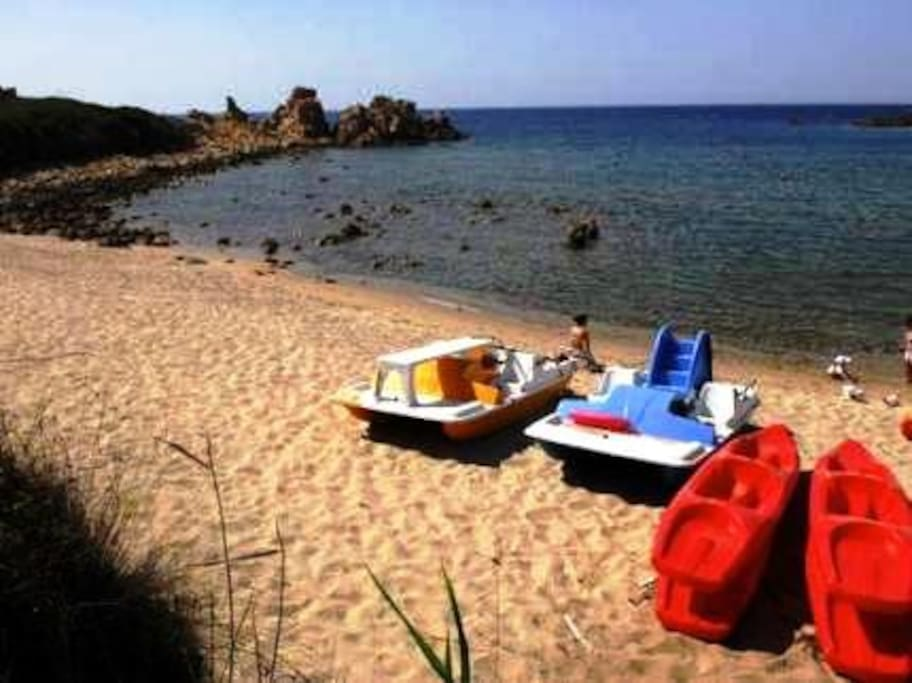 Canoes And Pedalos Available On The Beach