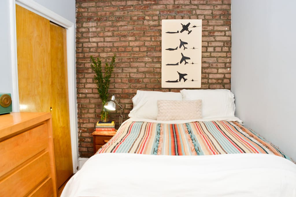 the smaller bedroom, which has a bit of exposed brick
