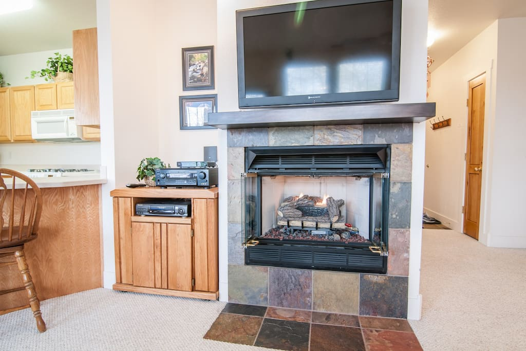 gas fireplace, flat screen cable tv, surround sound stereo, vcr and dvd players