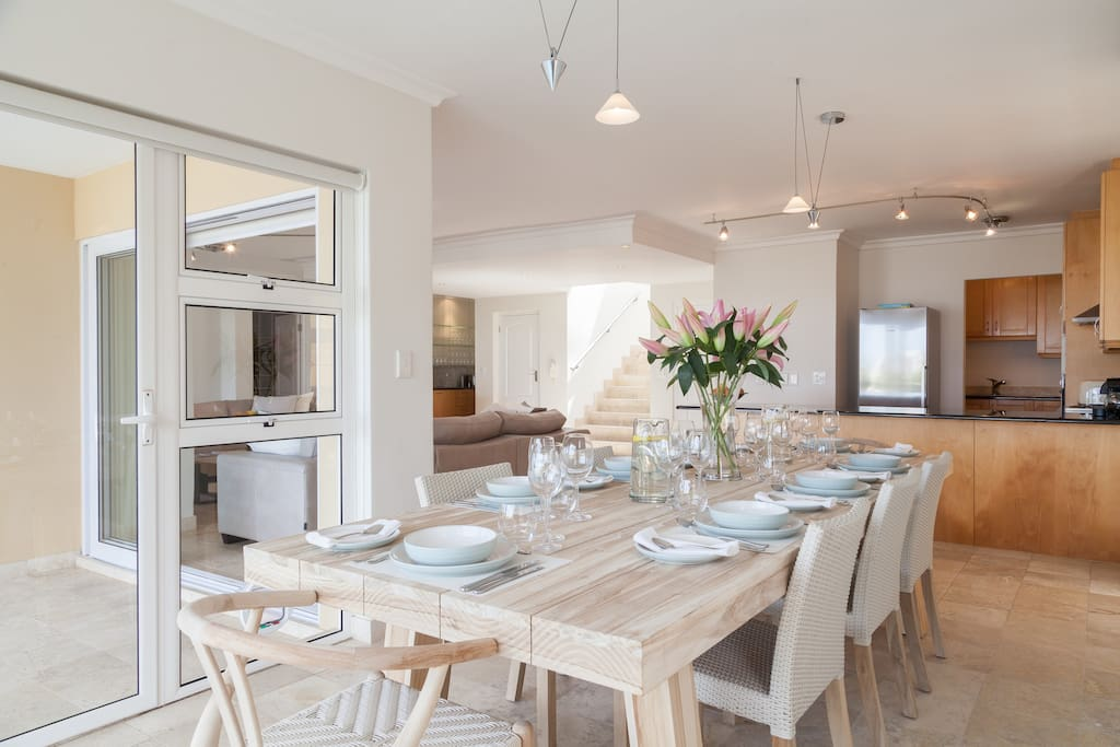 Shared open plan dining area with access to private pool and patio