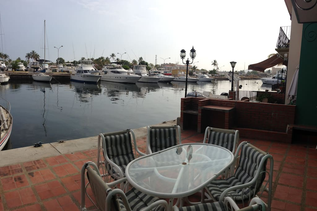 back patio facing marina; holds 30 people