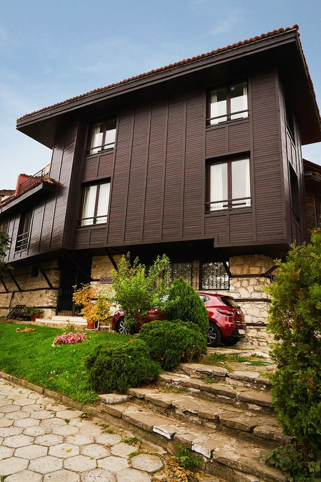 This beautiful summer house is situated in the UNESCO-protected Old Town of Nesebar. It directly overlooks the Black Sea and the bay of Sunny Beach and Sveti Vlas, there are no other buildings obstructing the sea view. The house is newly built and fitted with modern furniture but also has its own certificate confirming that it conforms to the requirements of the Bulgarian Renaissance architectural style, which is the prevalent style of the buildings in the Old Town. There is space for parking immediately in front and to the side of the house, visitors will receive a special pass for vehicle entry to the Old Town (where vehicle entry is restricted only to residents and hotel guests). We believe that this house is one of the gems of the Old Town, it has a special charm due to its location which provides unique sunset views as well as due to being an integral part of the architectural landscape of the Town. Take this unique opportunity to stay in style at one of the oldest historical towns of Bulgaria, explore directly the Roman, Medieval and Bulgarian Revival sites which will be (almost) literally in your back yard, enjoy your meal in a dining room with a picturesque (and totally instagramable) view, relax on a terrace feeling the sea breeze. If you ever get bored of history and the Old Town, please venture out, some of the best beaches of the Southern Black Sea are in immediate proximity (The South Nesebar Beach and (of course) Sunny Beach), the nightlife of Sunny Beach is only 5 minutes away by car and the classy yacht port of Sveti Vlas can provide a further pinch of entertainment to the fussy ones.