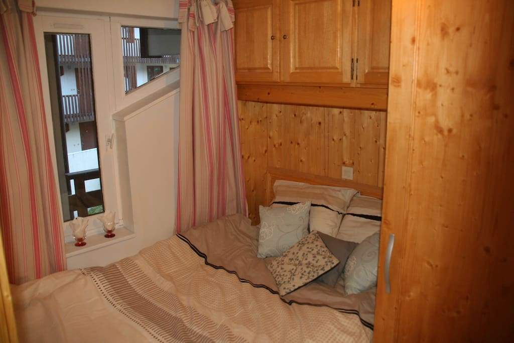 Cosy cabin bedroom with double bed