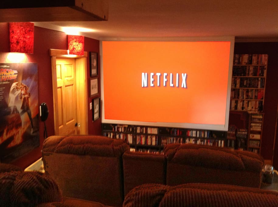 Audience view of 8 foot wide screen streaming Netflix movies.