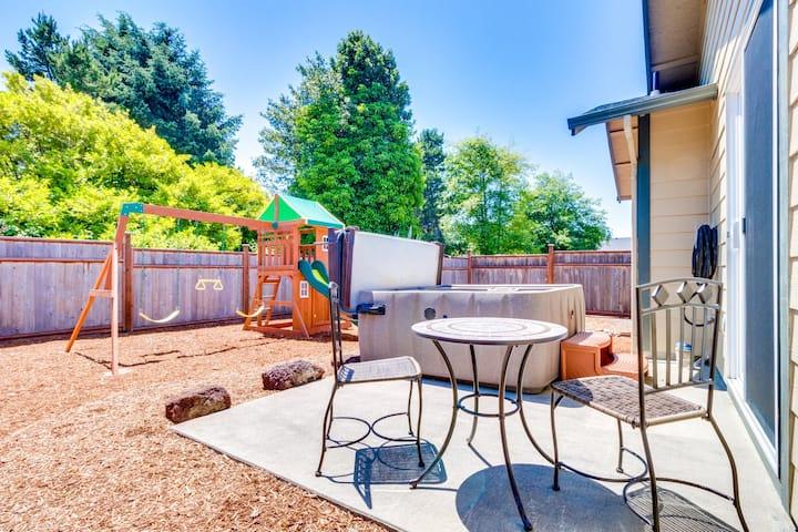 House near beach; enclosed yard w/hot tub & play structure!