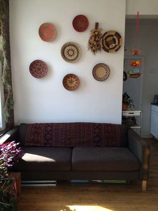 Our couch in the common area. Annie's collection of baskets on the wall.