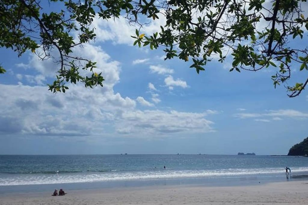 Relax and enjoy the amazing white sand and beautiful blue water underneath one of dozens of shady tress that line the beach!
