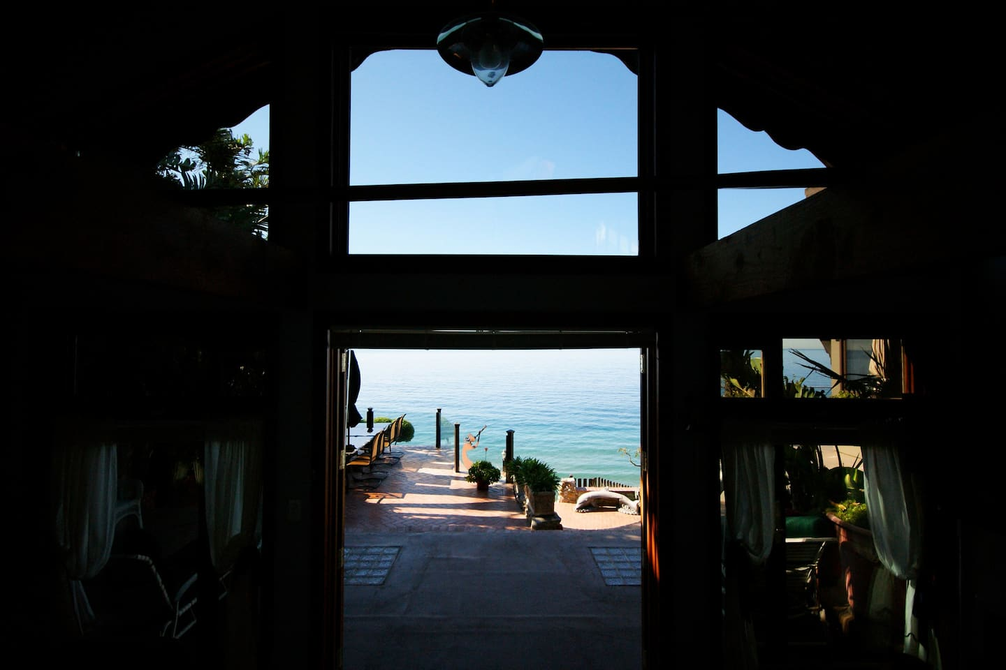 View from Guest House with patio and ocean below.