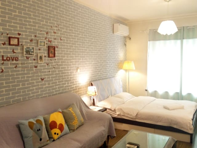sunroom解放碑城市夜色  清新小居室 - Chongqing - Flat