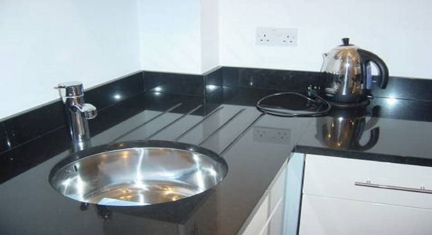 Modern fitted kitchen with granite tops