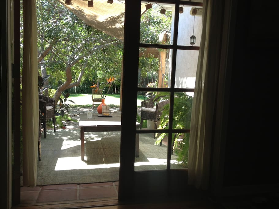 view from back den, french doors leading to 1 of 2 patios.