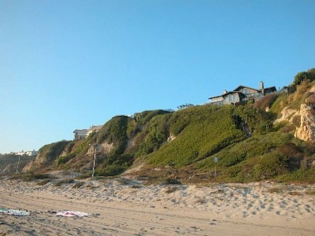 View from Westward Beach showing steps up bluff to our    Enchanted Sea Cottage.