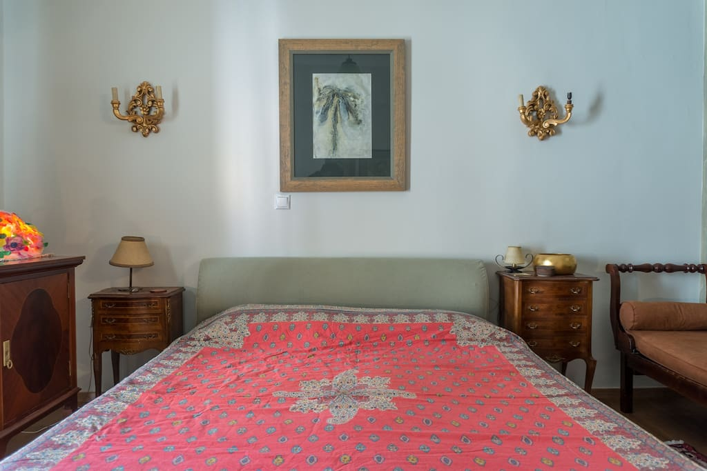 A  comfortable bed with vintage bedcover