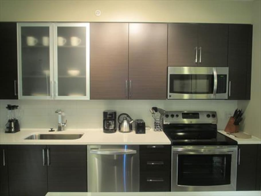 Fully equipped kitchen with full size appliances, pots, pans and dishes