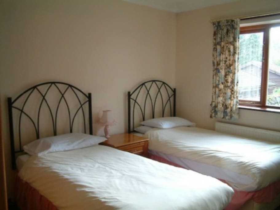 Parklands, bedroom, Lakes Cottage Holidays