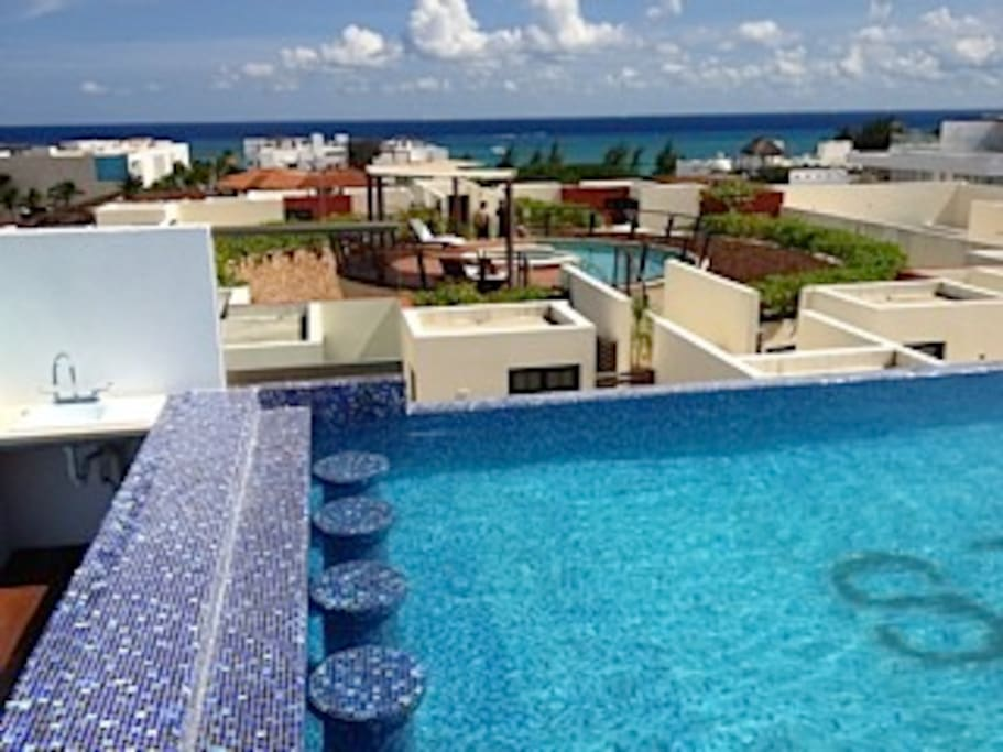 Beautiful small rooftop pool with view to crystal blue ocean!