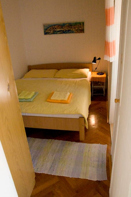 Bedroom with a large double bed and spacious wardrobe