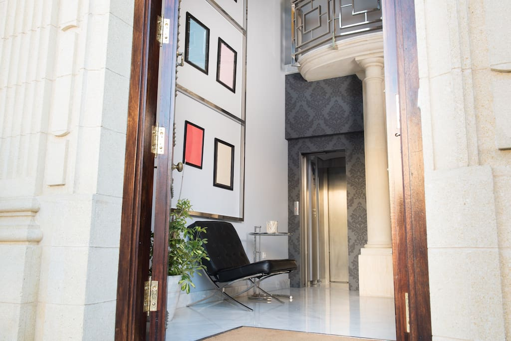 Entrance Hall - elevator and stairway access to the living accommodation on 1st floor