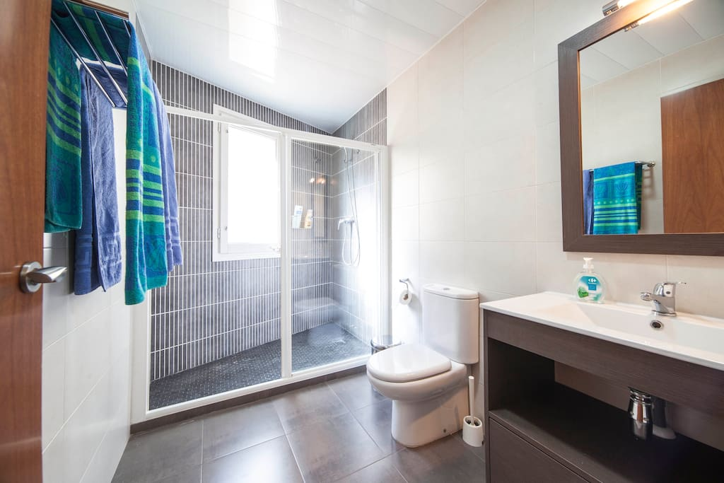 Your room with private bathroom, AC, TV, WIFI and plenty of privacy.