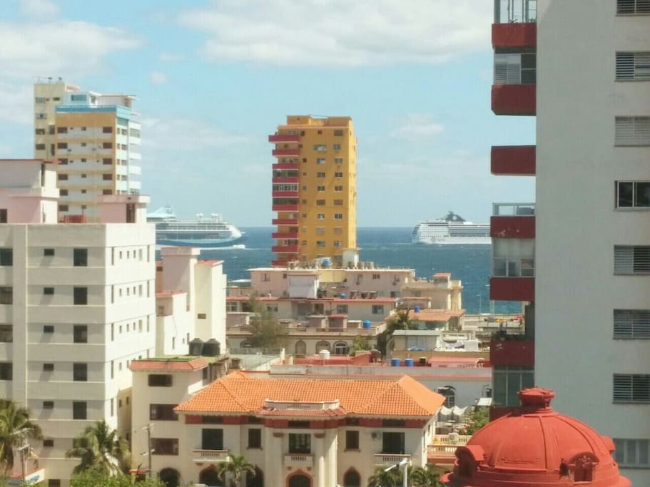 Panoramic view of the city and the sea from the balcony of the apartment.
