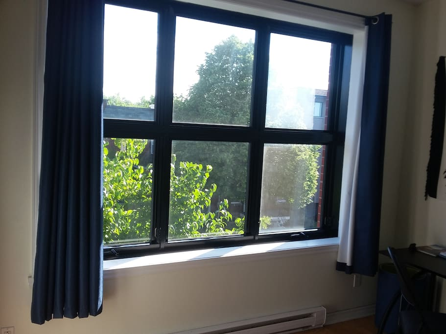 Wide Windows and Curtains that will bring you a full blackout to let you sleep during the morning ;)