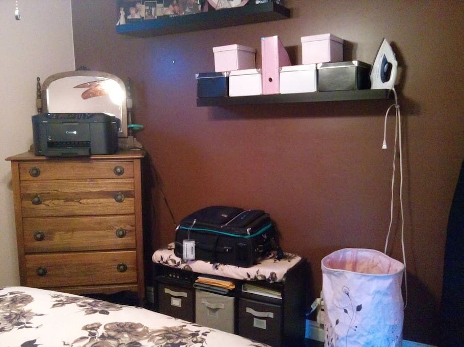 Bedroom area with a place to unload your suitcase, print or fax documents, and iron!