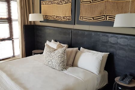 Master bedroom. Soothing modernist interior with sumptuous bedding