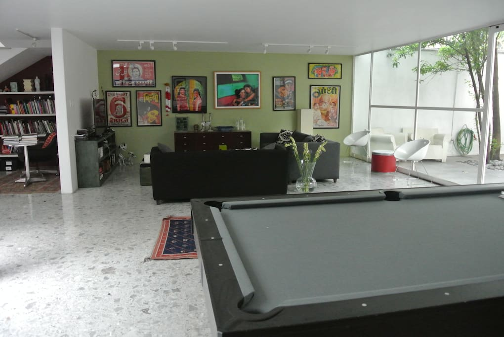 full size pool table with view of living area and library area...