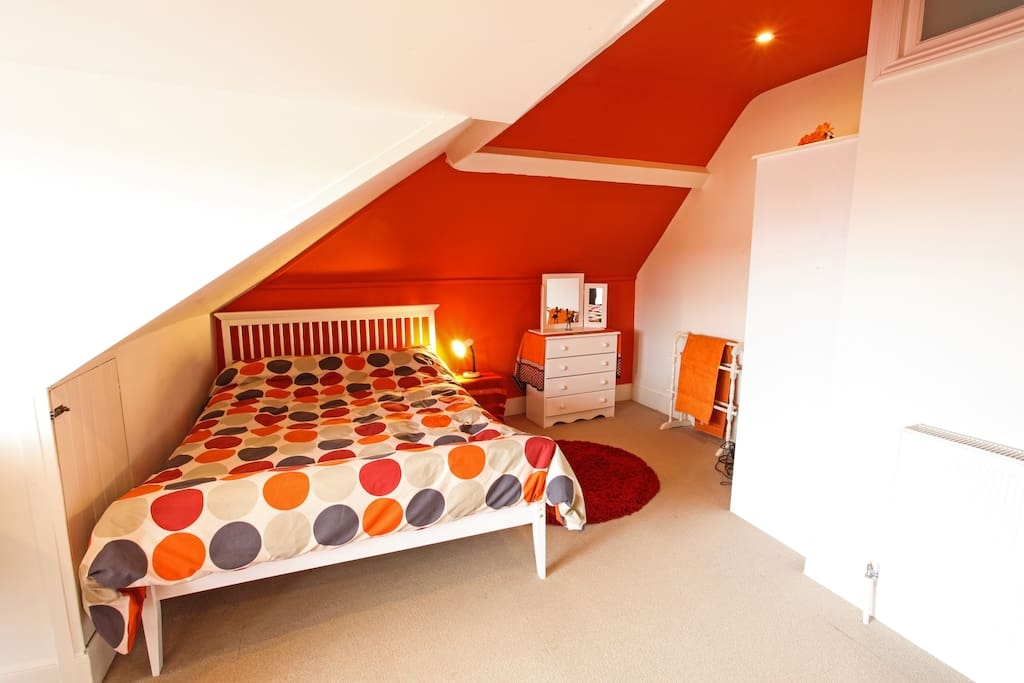 A comfortable double bed under the eaves
