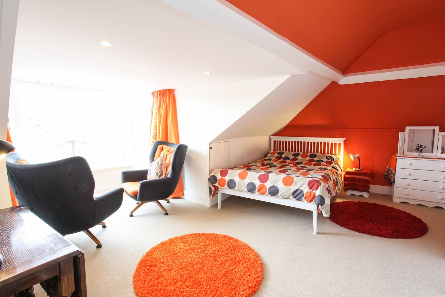 A sunny attic  room with a retro feel