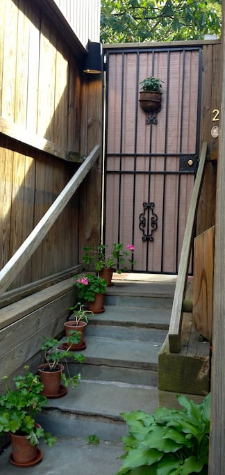 From the driveway, five not-so-tall steps leads to the entry gate