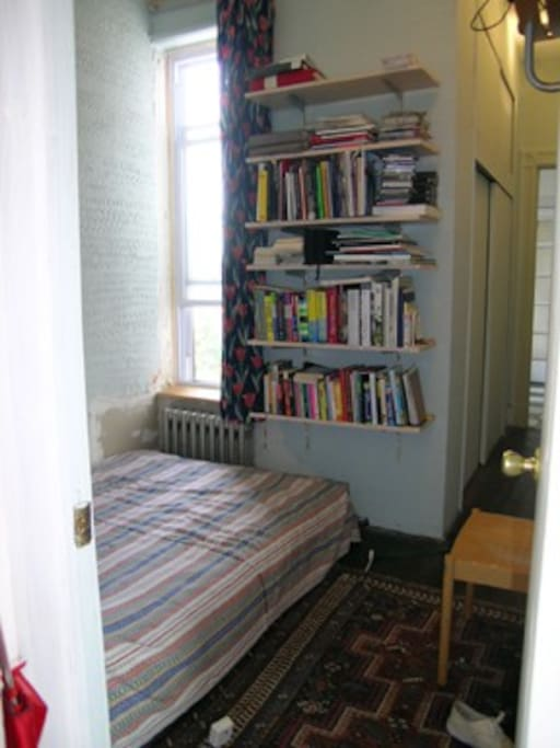 This is your bedroom with wardrobes to the right leading to the study