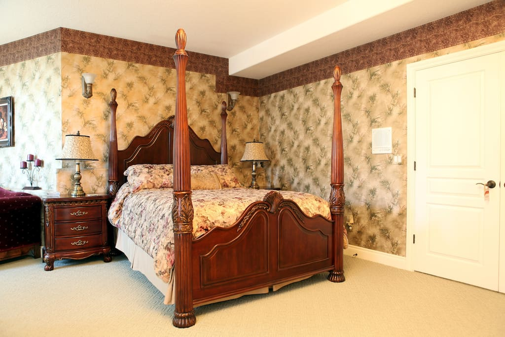 One of several hand-carved 4-poster beds, pillow-top mattresses and luxe bedding!