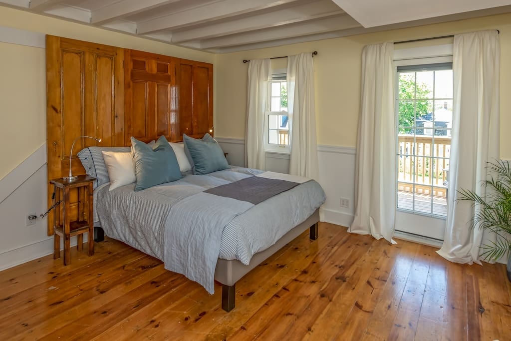 This bedroom is so charming and tastefully decorated. It is spacious and bright! with the added bonus of being able to walk right onto your own private deck!