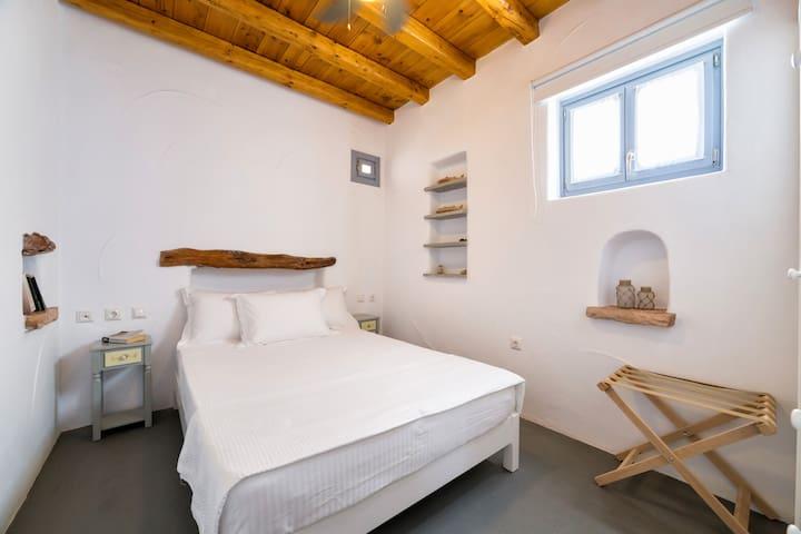 Βedroom with a double bed and ceiling fan