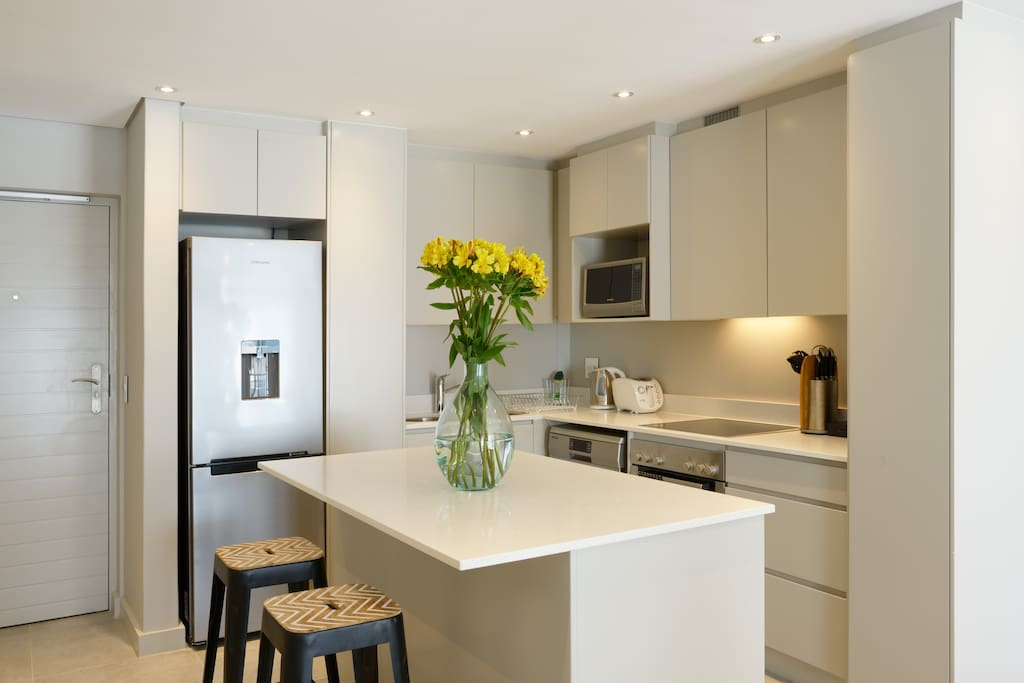Fully fitted kitchen includes washing machine, dish washer, Nespresso coffee machine and pods.