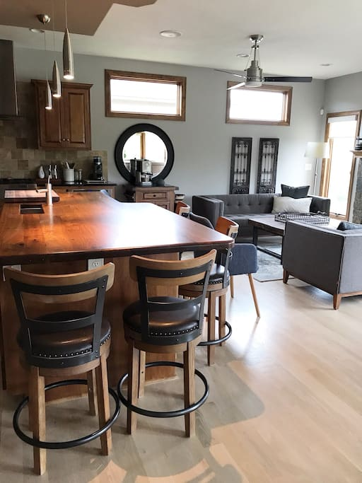 Beautiful eating chef's kitchen with hearth room.
