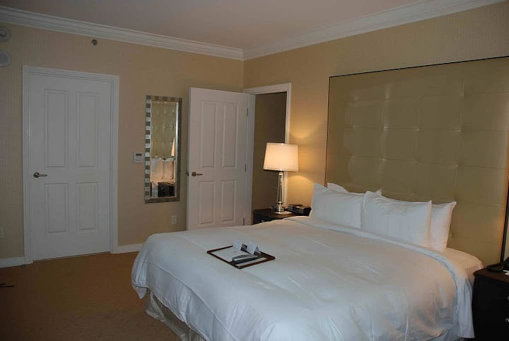King size master bedroom with a pop-up TV from the executive desk