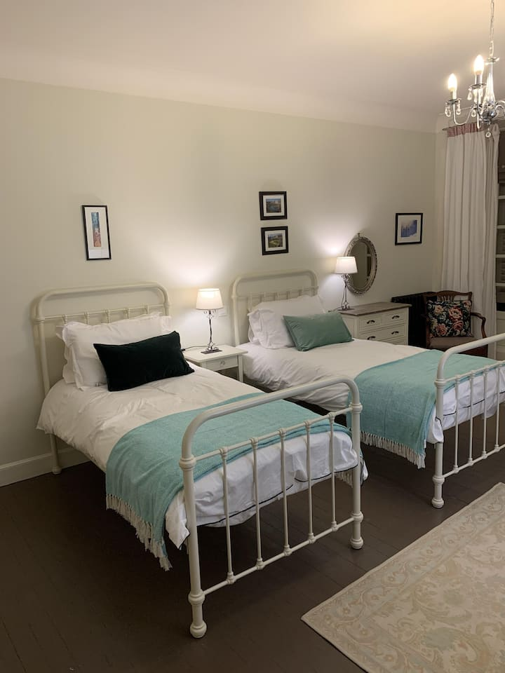 Ensuite with twin beds and garden view