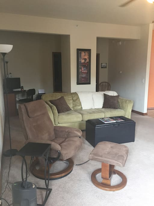 The living room has a massage chair, very comfortable couch and the top of ottoman flips over so you can set items on it or prop your feet up. Extra blankets and throws in ottoman.