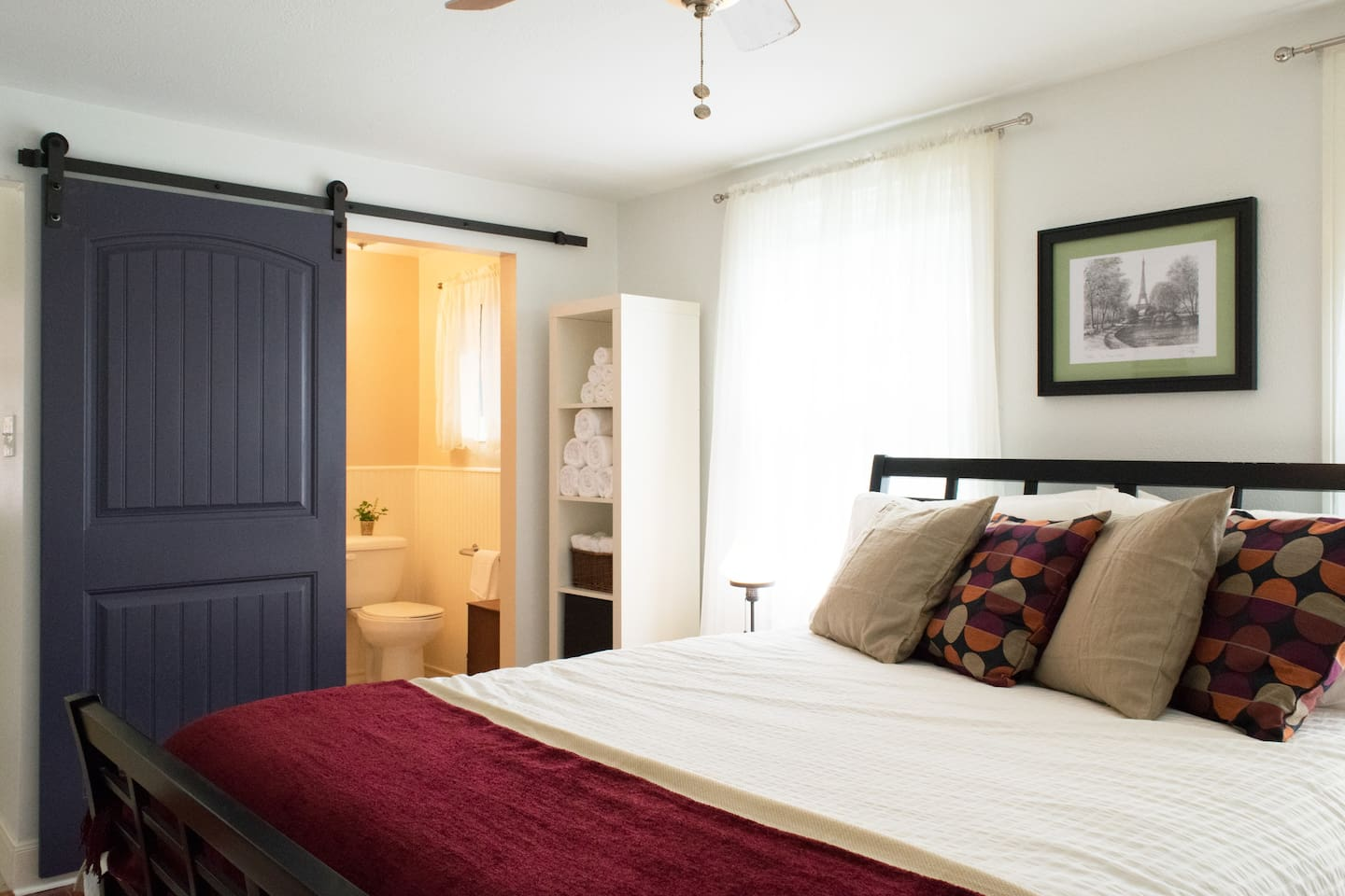 This private bedroom with lots of natural light has a full bathroom attached